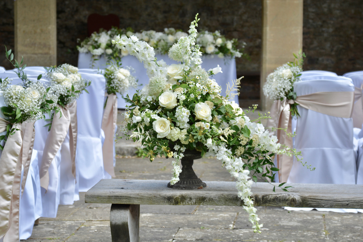 Image of the floral arrangements for the outside wedding ceremony at Dartington Hall