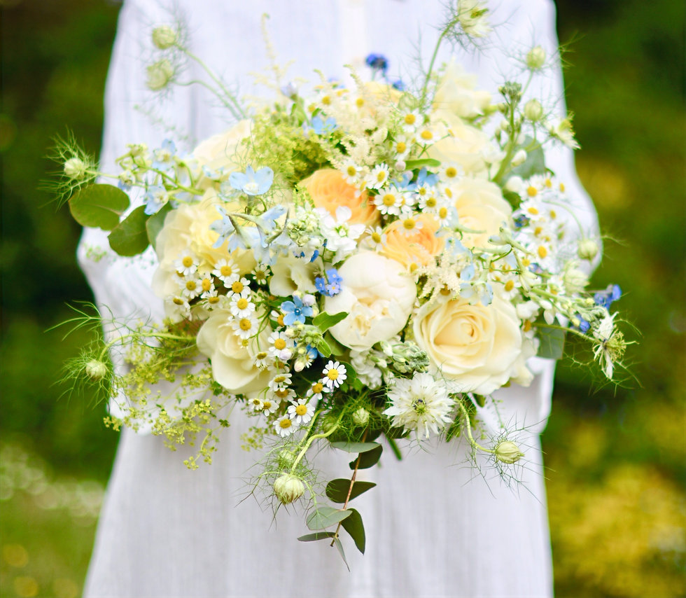fresh flowers bridal bouquet and white blouse