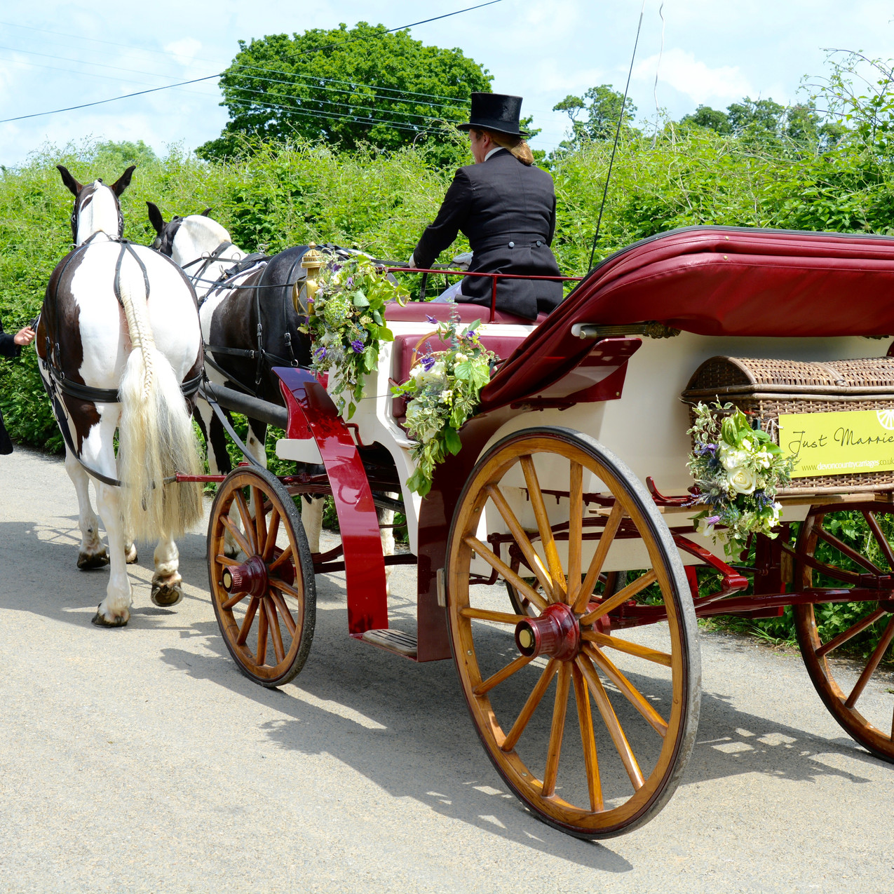 Horse and carriage dressed with woodland style floral arrangements
