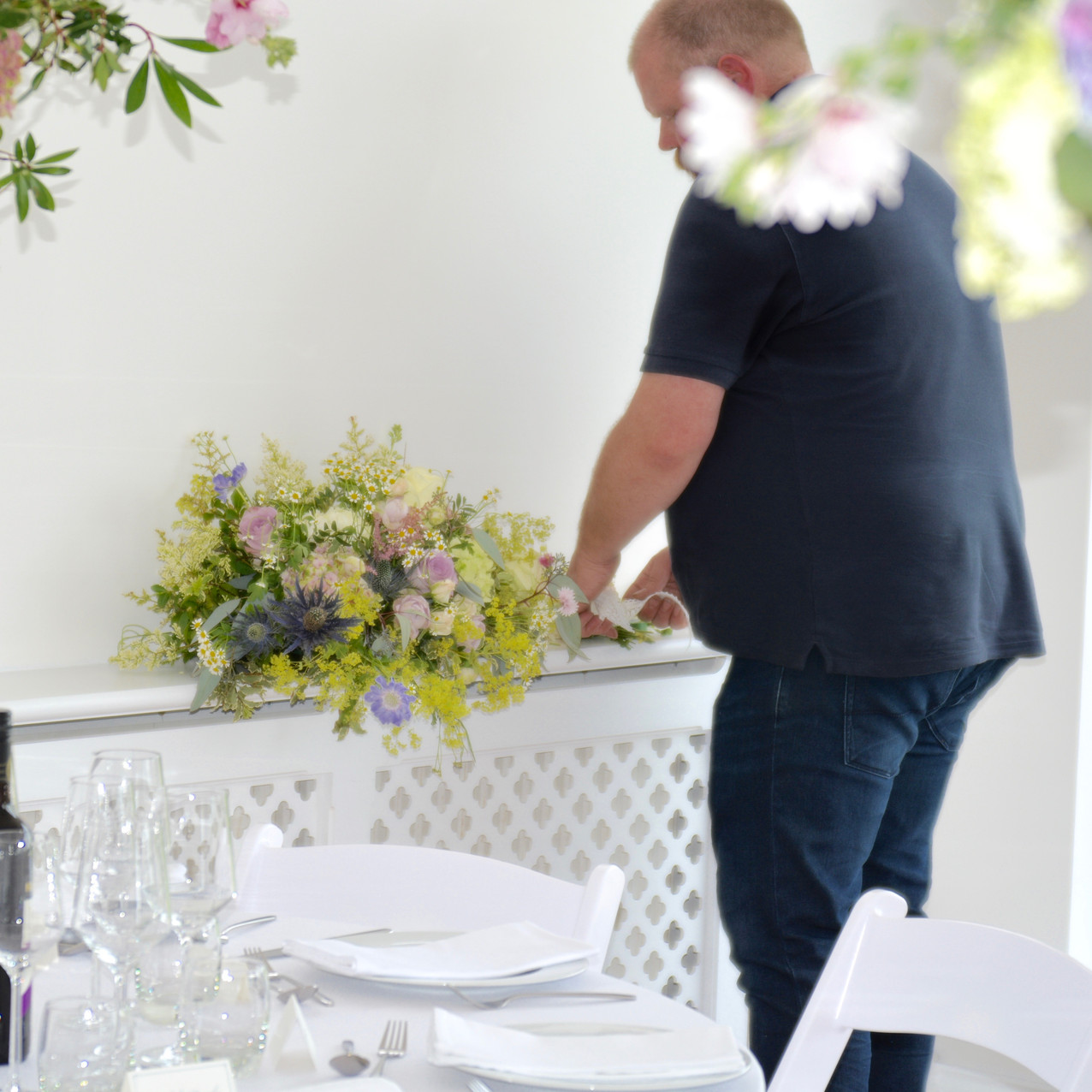 Don, arranging flowers in the reception bar at Kingston House