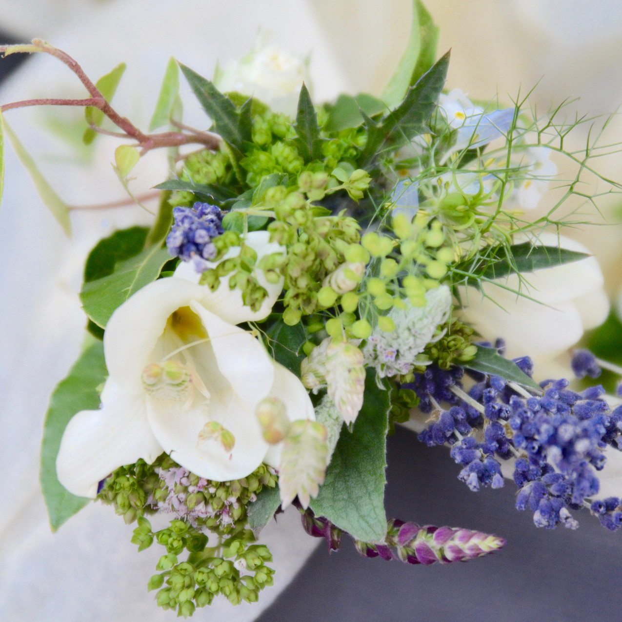 Ladies lapel corsage of herbs, freesias, lavender and ivy