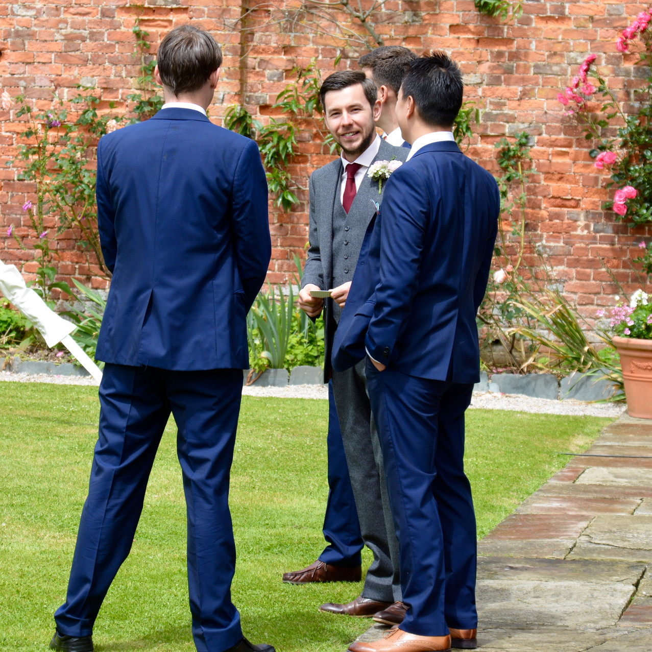 The Groom: Tarquin Clarke, wearing a grey wool suit - Brown in Town - http://brownintown.co.uk/