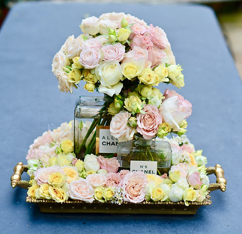 Chanel No.5 botlles with pink and cream roses