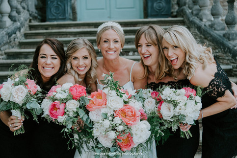 Bride with her bridesmaids and flowers