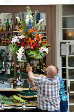 Tropical Flowers in tal vase on bar