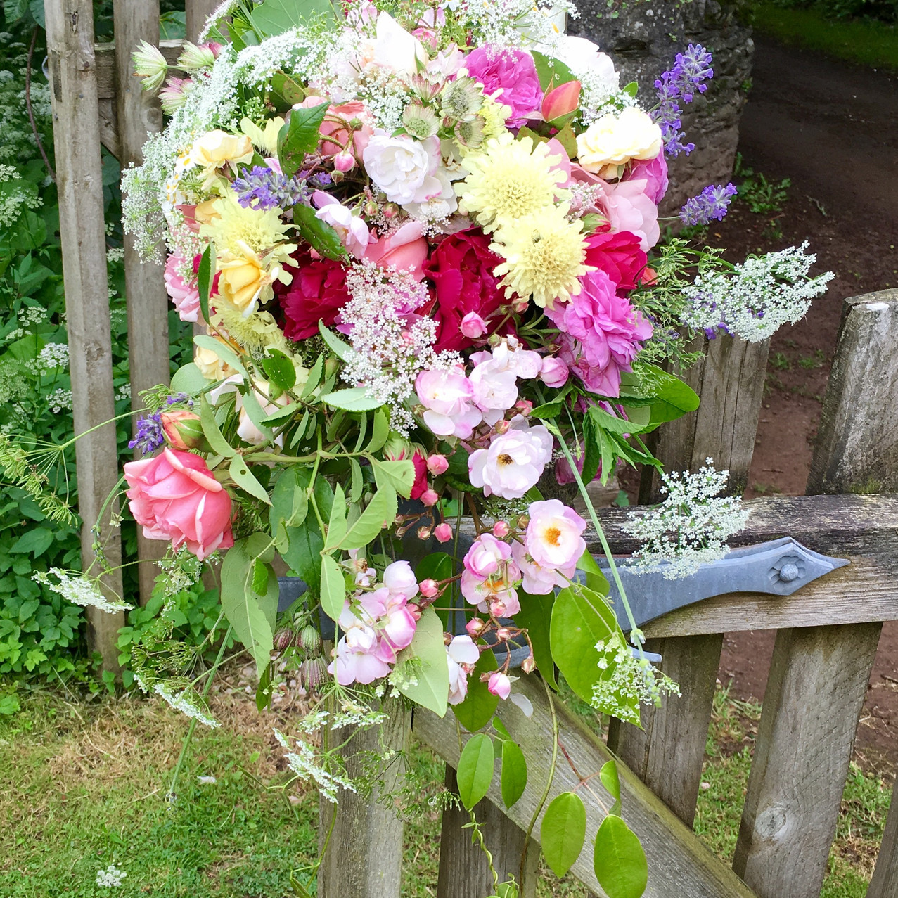 Alice's bridal bouquet for her Civil Ceremony service at Follaton House, Totnes. The bouquet is designed with flowers from her family home in South Devon, which Alice held for the service on Thursday, prior to her celebration of marriage event at Kingston House the following Saturday.