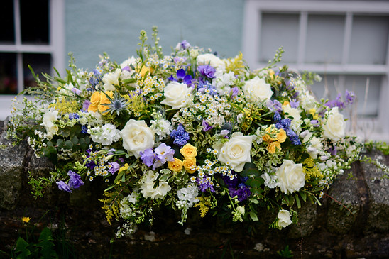 Coffin Spray of Ivory, Blue & Yellow Flowers