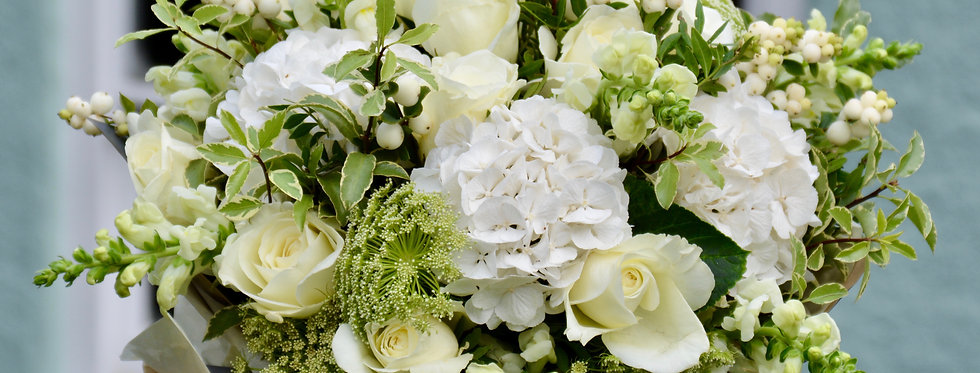 The Hunters Moon is a luxury size hand-tied bouquet of seasonal white and green flowers and foliage