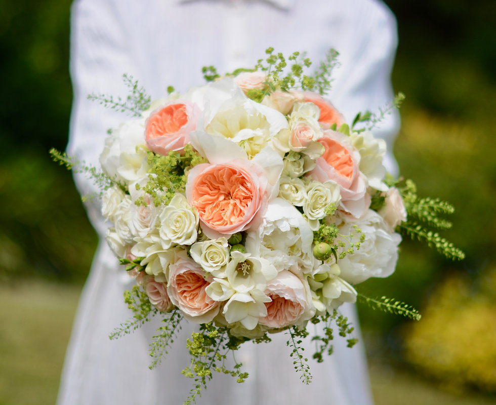 bridal bouquet of peach and cream flowers