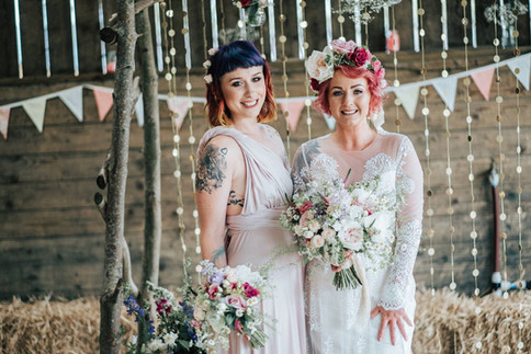 Bride with Bridesmaid and Flowers