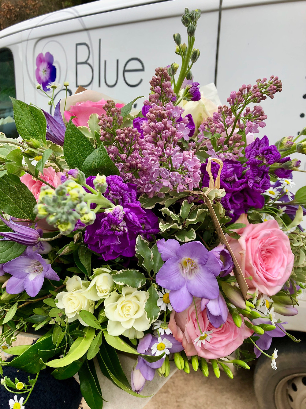fresh flowers, hand-tied bouquet, lilac, roses, freesias, stocks, vehicle, van Blue Geranium logo
