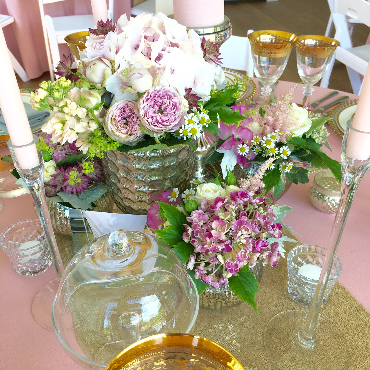 Low level vases with coordinating pink and ivory flowers at the Barn, Kingston House Devon