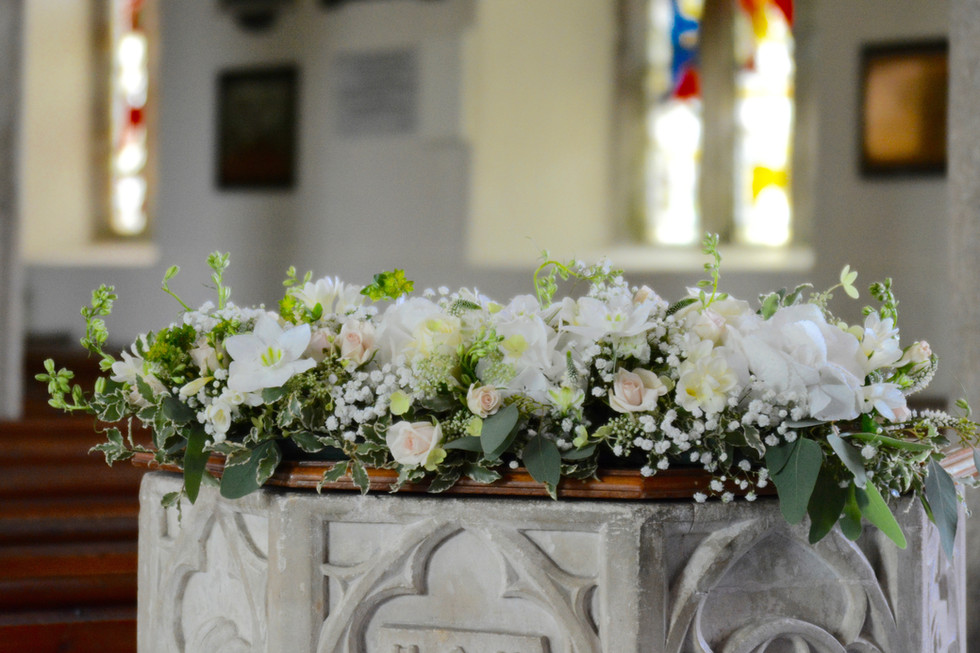 Long & Low Arrangement of White and Green Flowers and Foliage