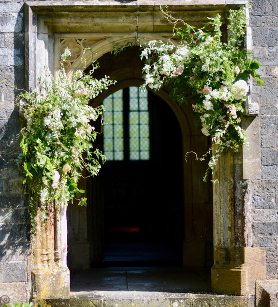 Asymetric Floral Arrangement at Church Entrance