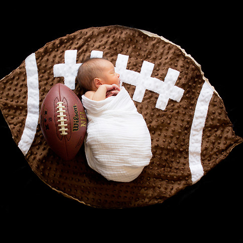 Newborn Portrait of baby and football