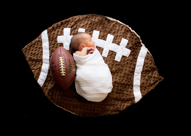 Newborn Portrait of baby and football