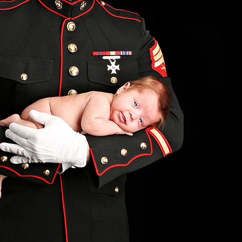 Newborn with Dad in his arms