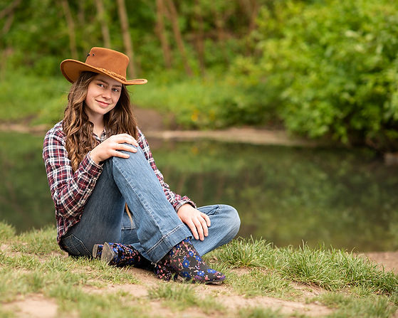 Lancashire Portrait Photography girl with cowboy hat by water
