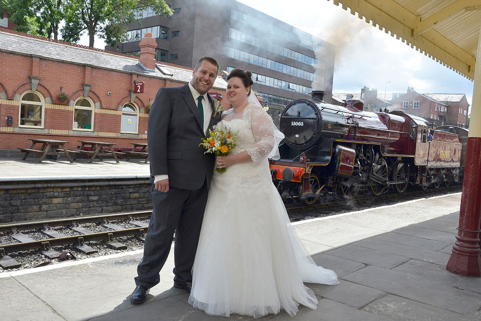Bride & Groom in front of train, railway station wedding photography Lancashire