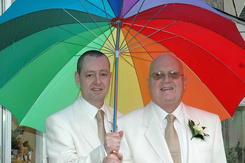 same sex wedding with rainbow umbrella groom & groom Lancashire photography