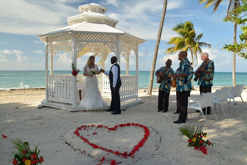 Destination aborad luxury wedding bride & groom with red heart in sand wedding photography Ambience Images