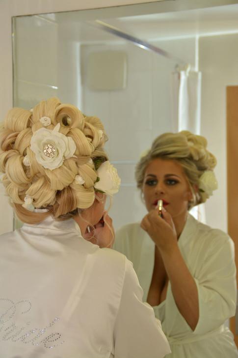 Bride putting on makeup lancashire wedding photography