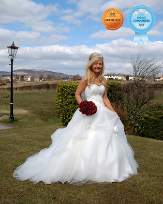 Bride with white dress and red bouquet award winning wedding photography Ambience Images