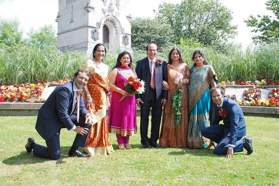 Indian Family at Wedding standing outside in sunshine. Ambience Images wedding photography