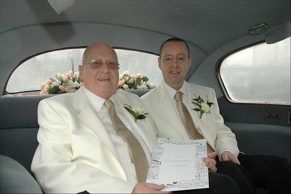 groom and groom in car, same sex wedding photography Lancashire Ambience Images