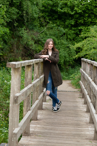 Girl leaning on bridge, Lancashire outdoor portrait photography