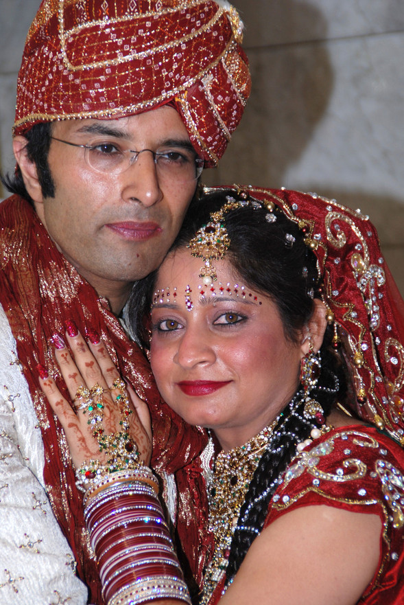 Indian wedding close up of bride & groom in traditional headwear Ambience Images Lancashire Photography
