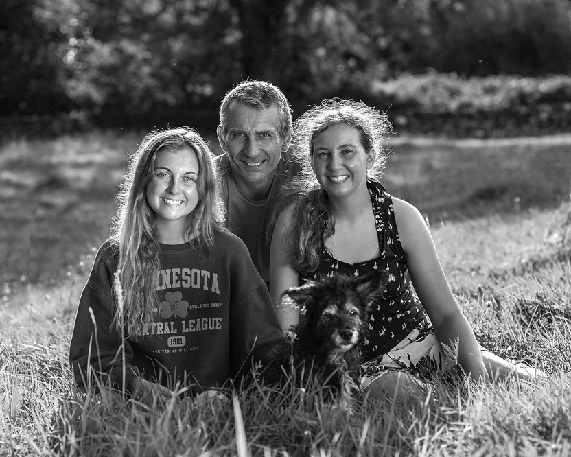 black & white sisters with dad outside