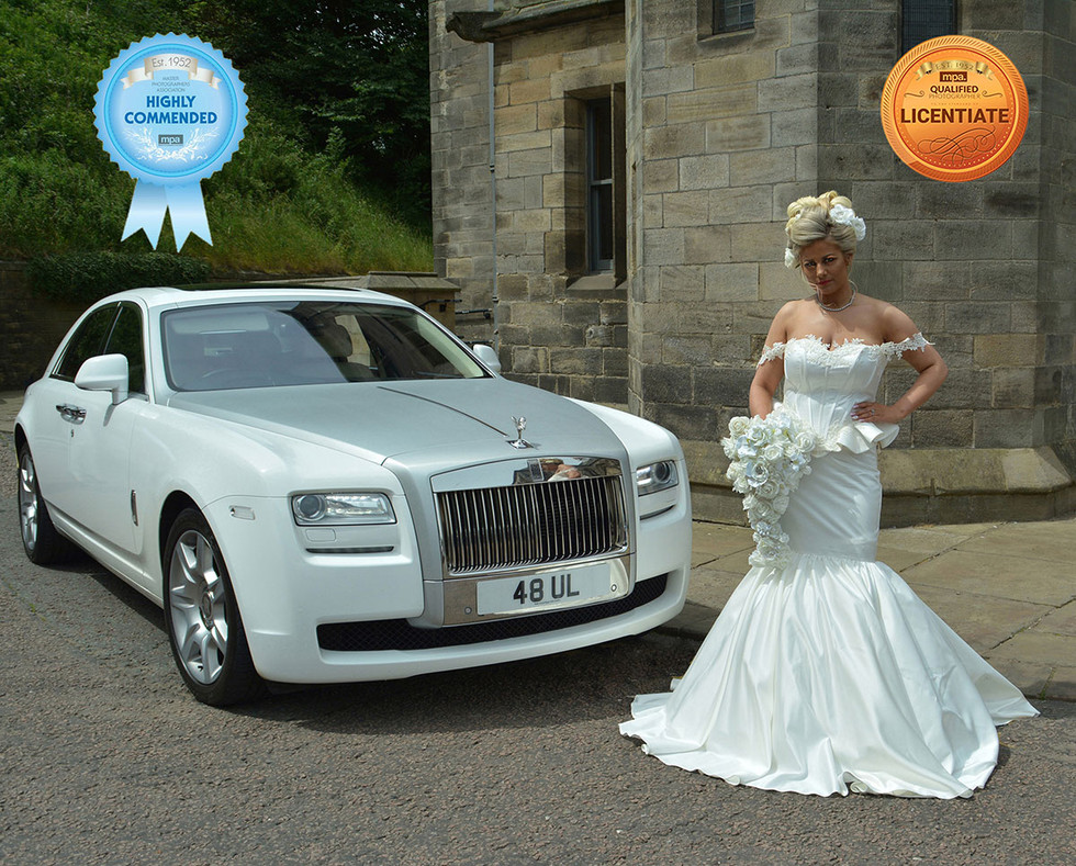 Bride with car award winning wedding photographer Dave Pitts