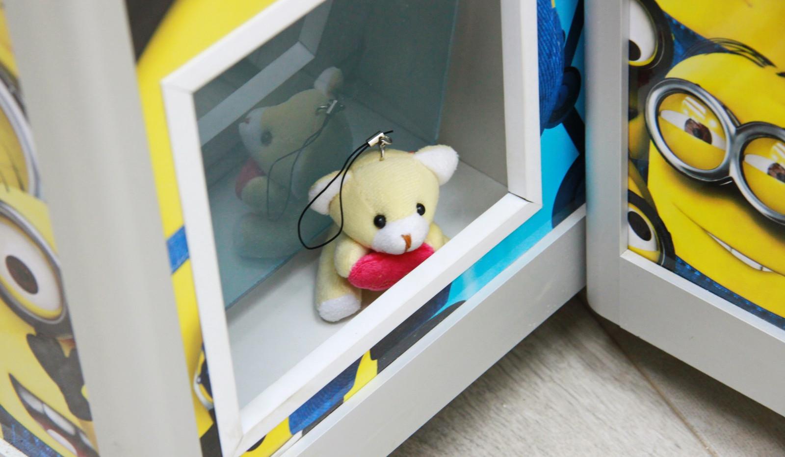 Игрушка в окне выдачи приза.jpg
