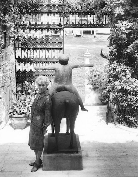 Peggy Guggenheim stands outside her museum in Venice