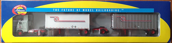 G I Trucking Freightliner with 28ft Trailers & Dolly - Athearn