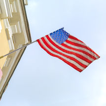 American flag flies on the building of o