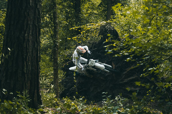 """Anthony Rodriguez """"Arod"""" rides sideways on a fallen tree at a motocross track in South Georgia"""