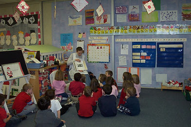 Children learn about the Huble family from a previous Education Coordinator.
