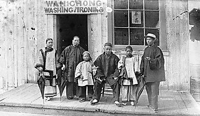 The Wah Chong family pictured outside the Wah Chong Laundry in Vancouver.
