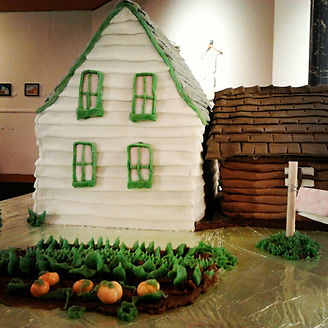 The Huble House in cake form. Created by Carla Highsted.