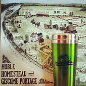 A map of Huble Homestead mounted on a plaque in the backgrond, with a Huble Homestead travel mug in front of it