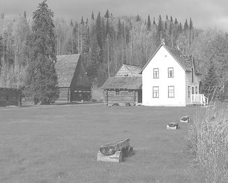Black and white photo of the Huble House in the foreground; the Society does not have a photograph of Pete Pierroy.