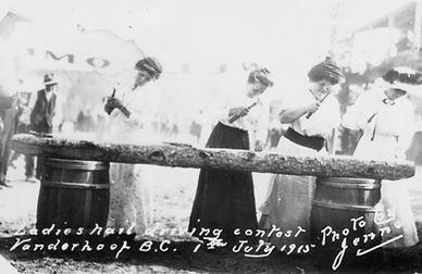 A ladies nail driving contest in Vanderhoof, 1915.