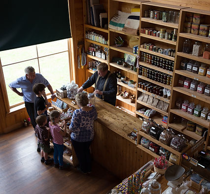 A family purchases candy in the General Store