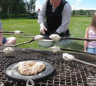 Making bannock at Huble Homestead.