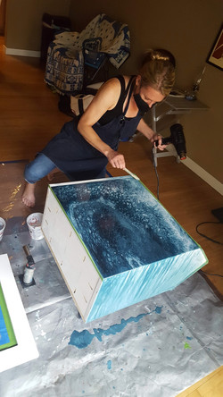 Resin painting a Little Free Library