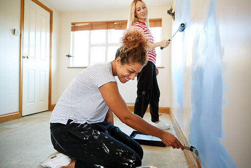 Two Women Decorating Room In New Home Pa