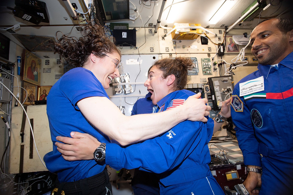 Astronauts Koch and Meir embrace aboard the ISS