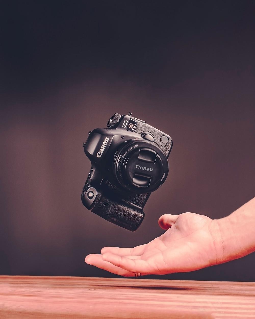 Hand catching falling camera